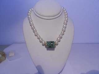 carved jade barrel  pearl necklace  14kt gold clasp