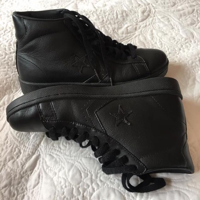 Converse leather high tops size men's 7/woman's 8.5