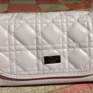 Dior Pouch Repriced