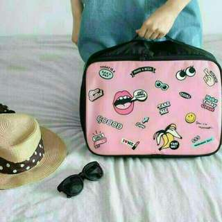 粉紅底趣味旅行收納包