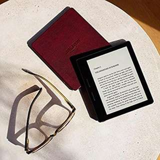 "New - Limited Stocks - Kindle Oasis E-reader with Leather Charging Cover - Merlot 6"" High-Resolution Display (300 ppi), Wi-Fi - Includes Special Offers. Includes Paid Kindle Books"