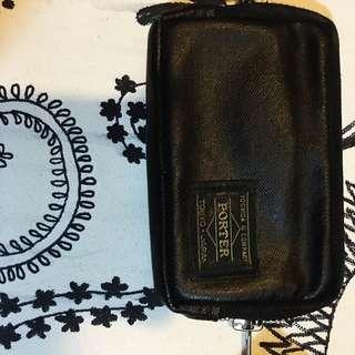 它是:日標porter吉田包零錢包