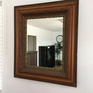 Antique wooden wall mirror