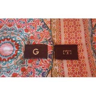 Authentic Guess coin pouches $10 each.