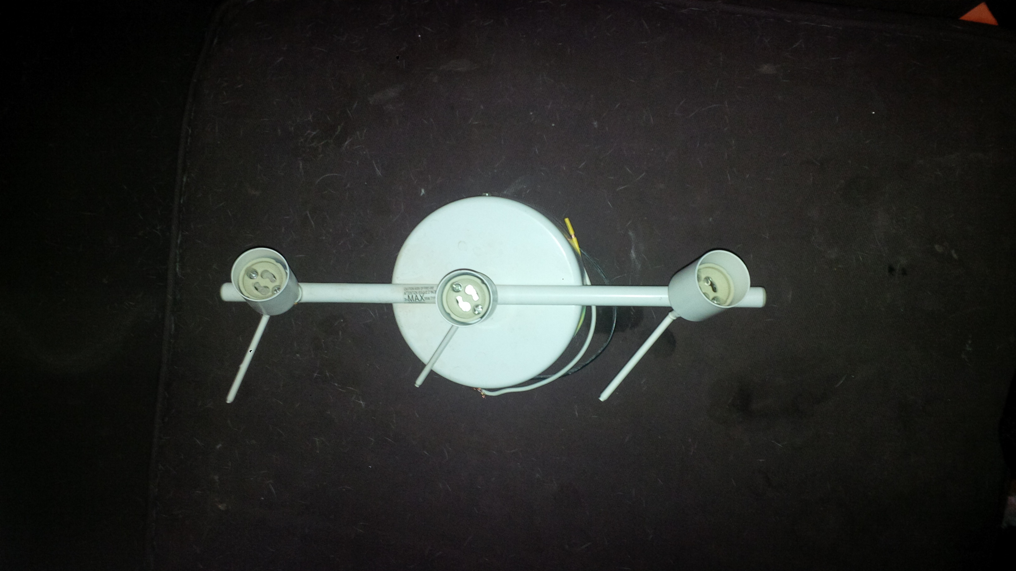 2 triple bulb holding ceiling lights