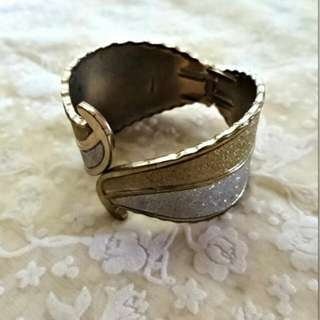 Silver and gold clip in bracelet