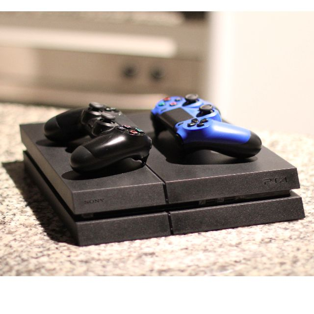 PS4 console and 2 controllers. Including games! 10/10 condition