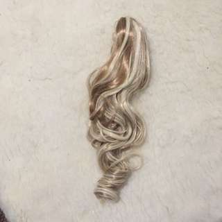 Blond Clip Curled Ponytail