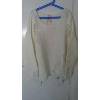 Distressed white knit