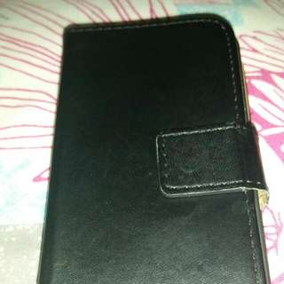 Iphone 4 with a black leather case