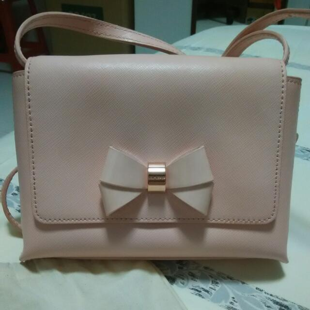 14aa06b2bfcd Ted Baker Sling Bag Rose Gold Bow (Price Reduced!!)