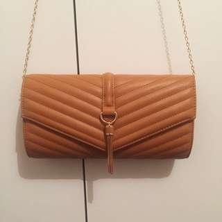 Tan Bag with Gold Tassel