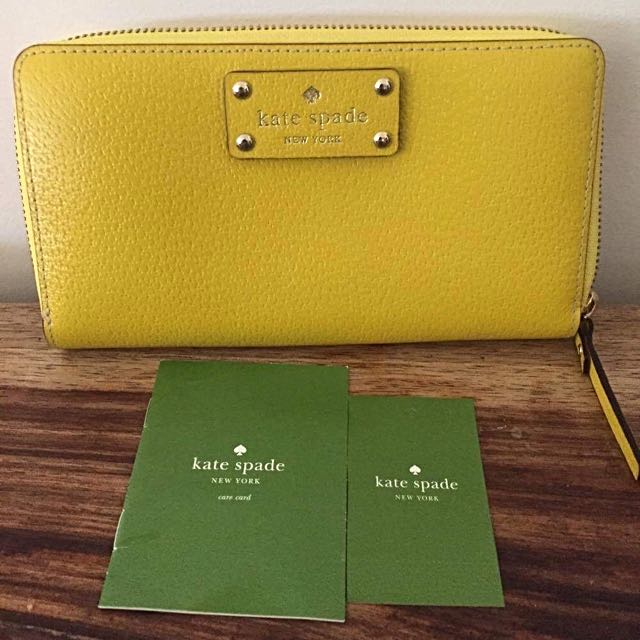 Yellow Kate Spade wallet w/ Authentication