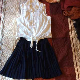 White Crop Top And Navy Pleated Skirt