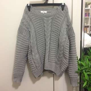 Grey cable-knit jumper