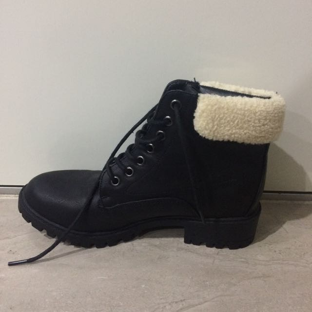 Black boots with wool detailing