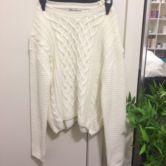 White cable-knit jumper
