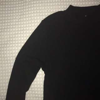 Ribbed Long Sleeved High Neck Top