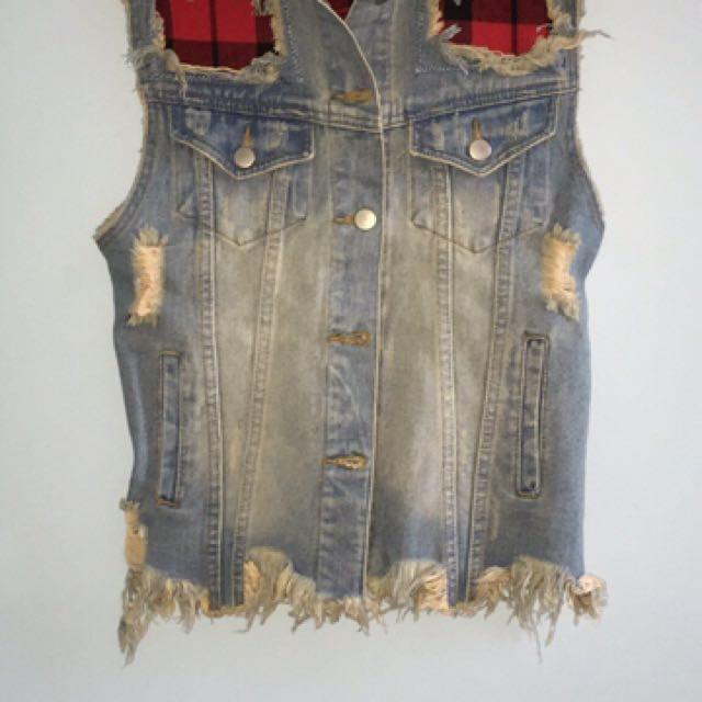 Blue distressed denim vest