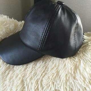 topi kulit import
