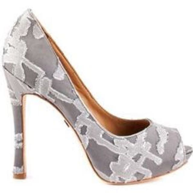 Badgley Mischka delivers a dark gray satin upper with sparkling silver embroidery.