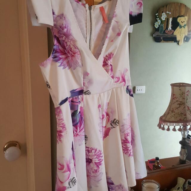 Floral white Playsuit Size 12-14