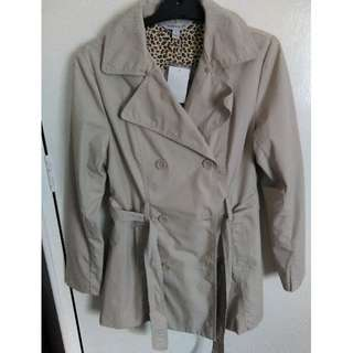 Faux fur trimmed trenchcoat. Brand new. Size 8.