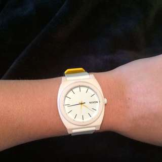 Nixon black white and yellow Watch