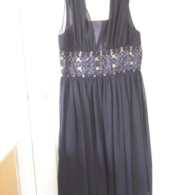 Black Dress With Gold Embellishments On Waist