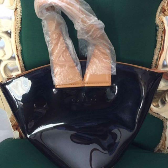 Excess Handbag