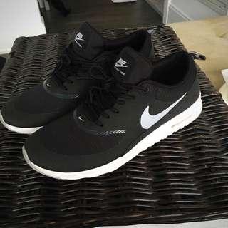 Black-and-white Nike Air Max Thea