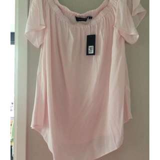 Woman's off the shoulder light pink blouse