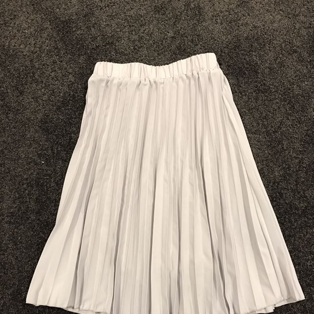 Grey pleat knee length skirt