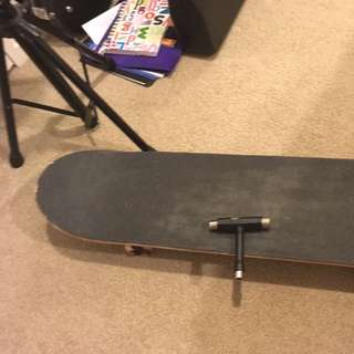 Deca Skateboard With Gear Key