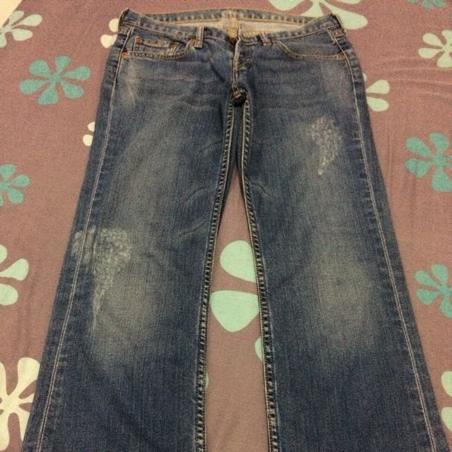 Authentic Levi's Super Low-rise tattered jeans