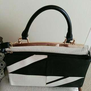 Beautiful Black & Creamy Colour Handbag Still In Good Condition Hardly Used