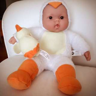 Baby doll with duck suit and mini duck