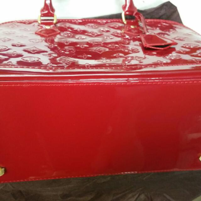 Louis Vuitton Glossy Leather Shoulder Bag..