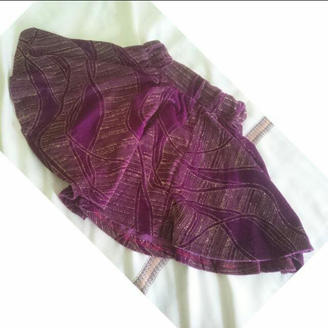 purple glittery skirt