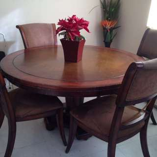 Round Brown Wooden Top Pedestal Dining Table With Four Brown Fabric Padded Chairs