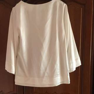 white blouse in satin fabric