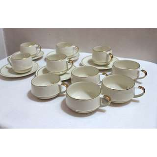 Tea cups and saucers with gold design