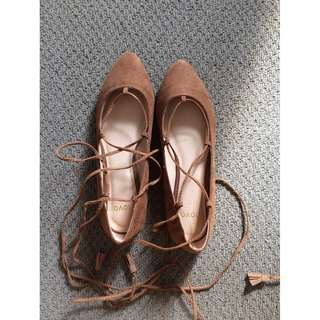 Brown lace-up style pointy toe ballet flats