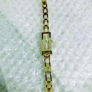 Gucci gold watch