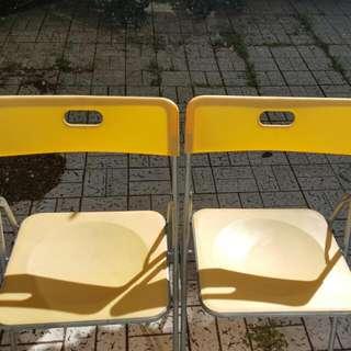 Six Yellow Plastic Folding Chairs