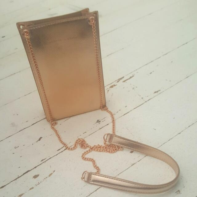 Charles & Keith Rose Gold Clutch