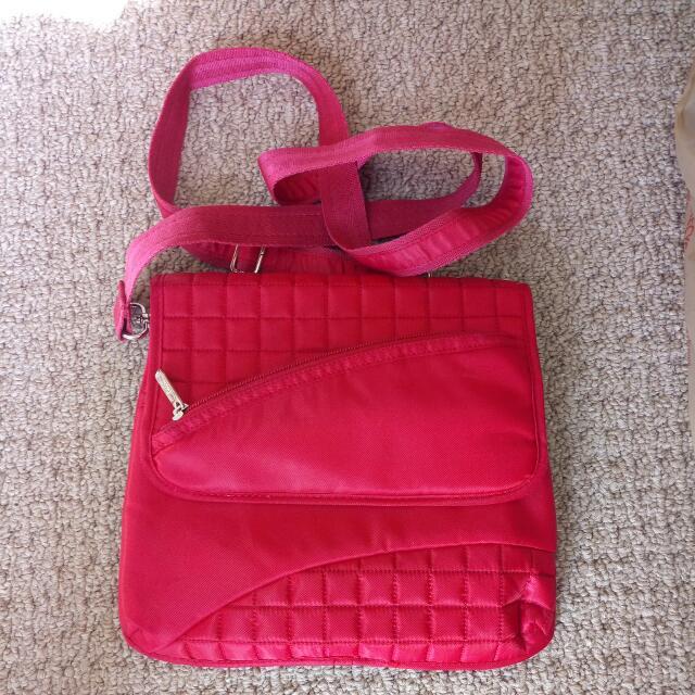 Lug small red crossbody bag