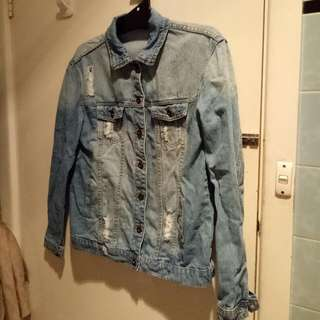 Distressed oversized denimn jacket