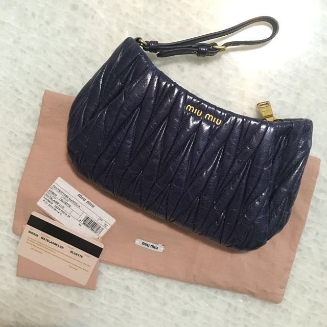 233aa2828bd12 Reduced from  470 Miu Miu Matelasse Lux Clutch   Wristlet, Luxury, Bags    Wallets on Carousell