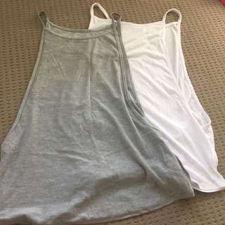white and grey supre tanks
